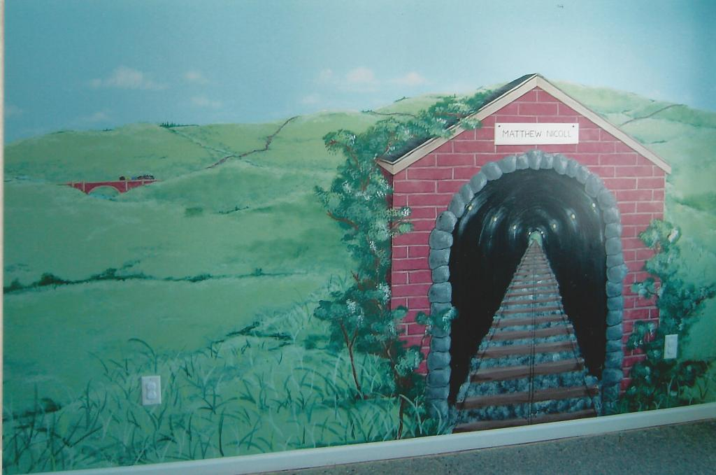 "Train-themed mural. The tunnel was the ""headboard"" for his bed."