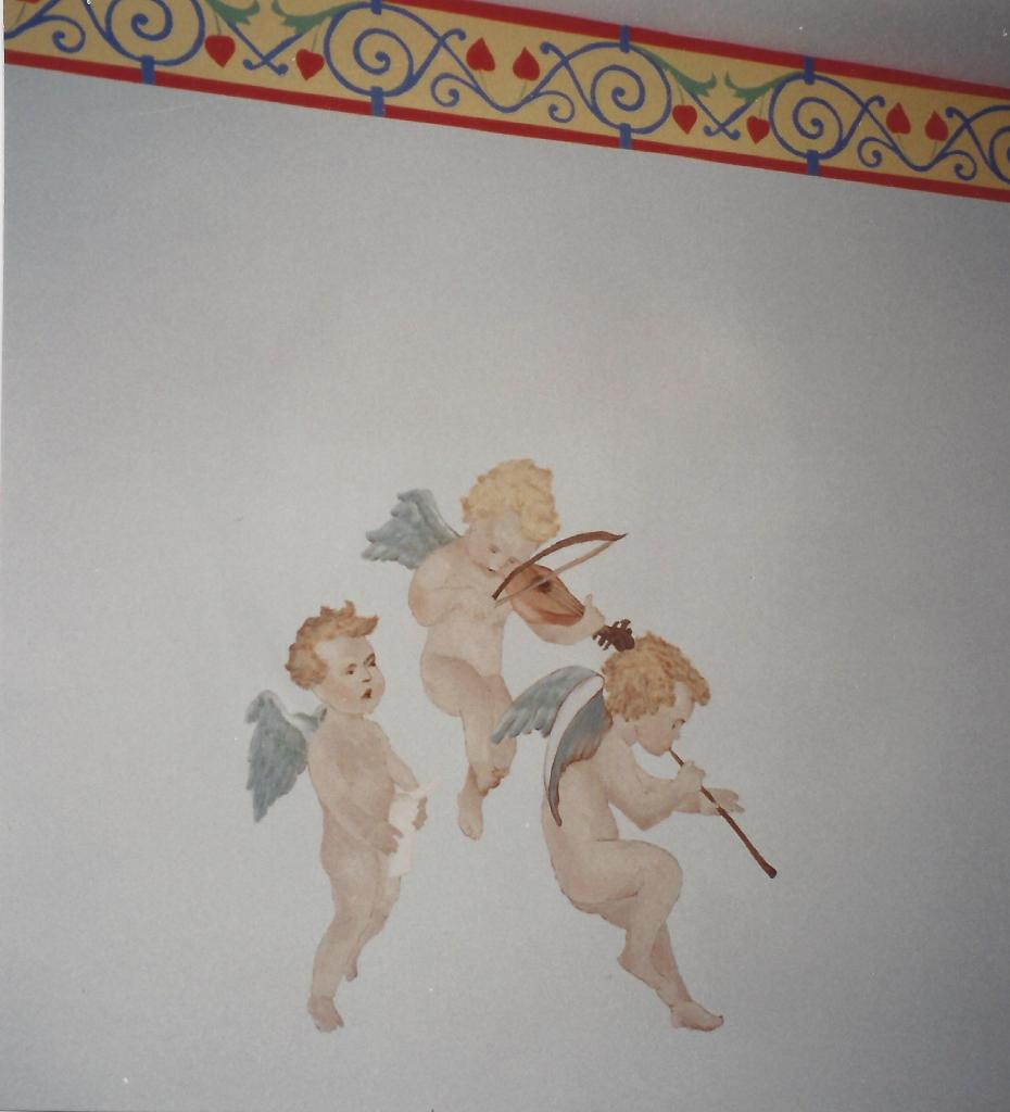 Detail of cupids over the crib.