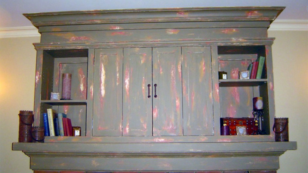 Newly constructed fireplace mantle painted with a multi-layered worn-through finish.