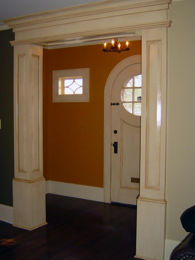 Columns and all woodwork in entry foyer painted with an antique glaze.