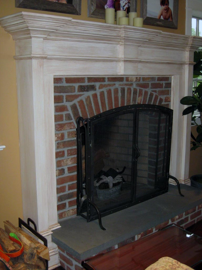 Antique glaze finish painted on fireplace surround.