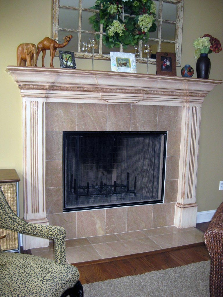 Antique glaze painted on white fireplace surround.