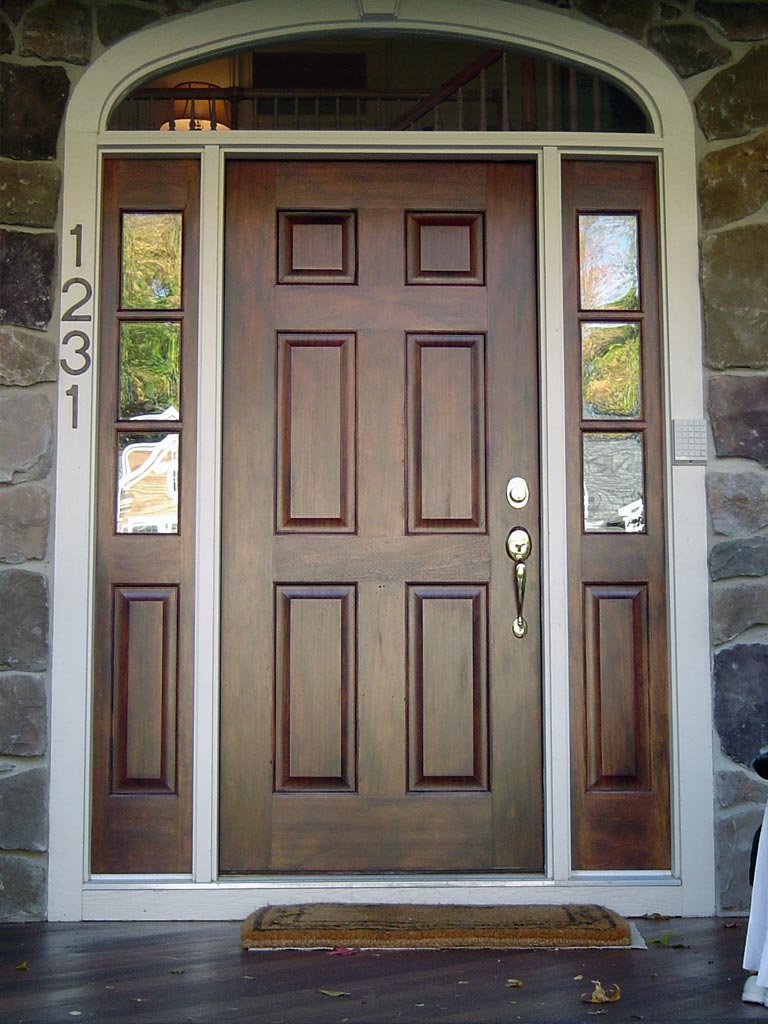 "Entry door and sidelights ""antiqued"" with chestnut glaze."