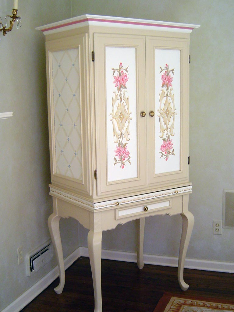 Armoire hand painted to coordinate with room decor.