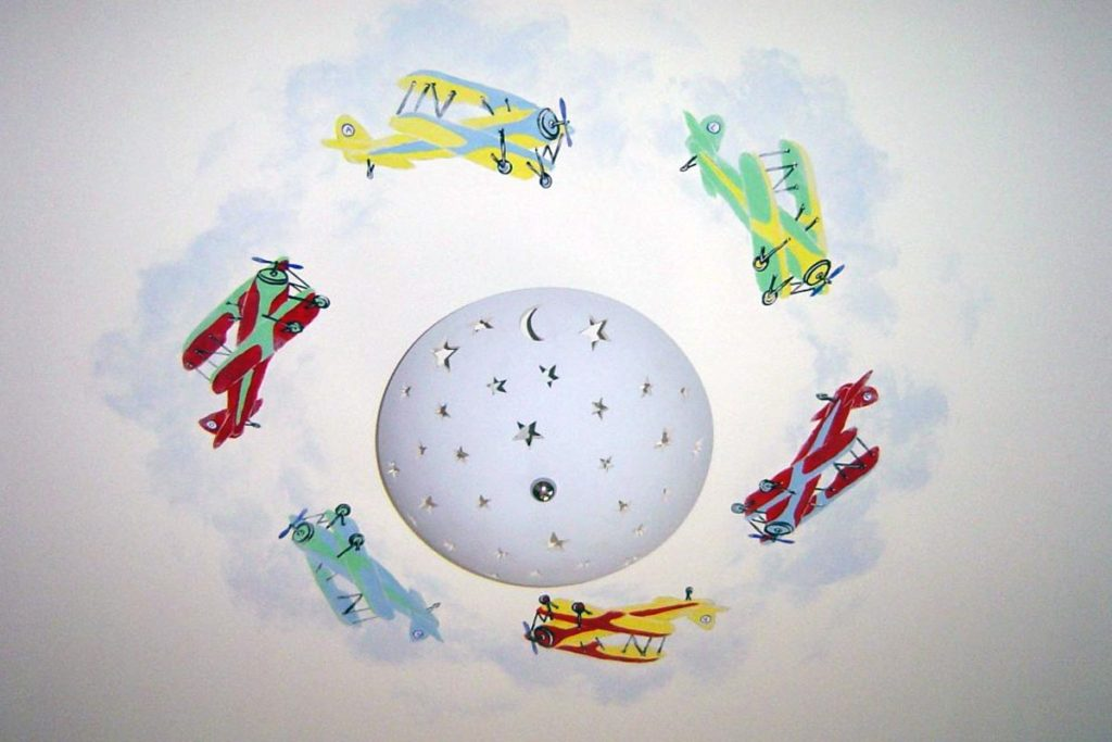 Bi-planes and clouds painted around light fixture
