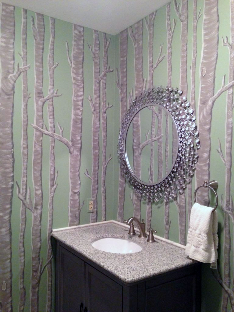 Birch tree mural painted throughout this powder room.