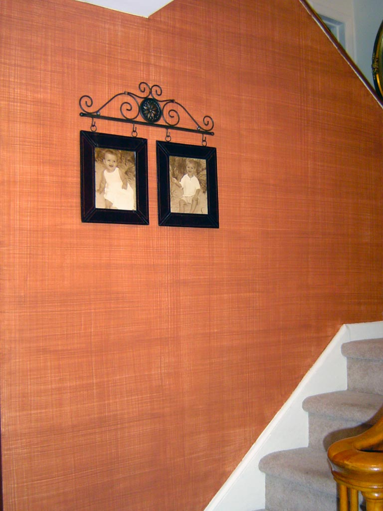 Burnt sienna linen-weave glaze in a foyer.