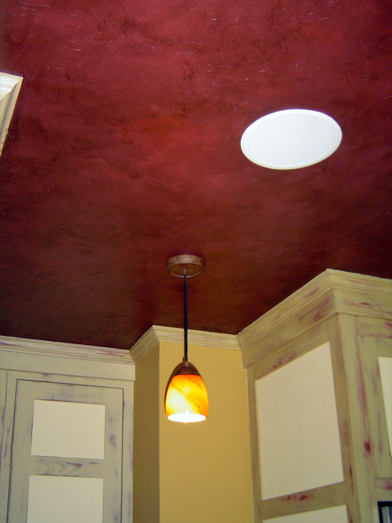 Cabana kitchen ceiling textured with crinkled tissue, and painted to resemble deep red leather.