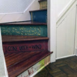 One classic book painted on each stair riser in this reading nook.