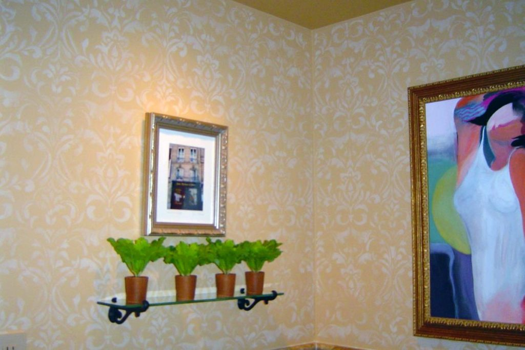Translucent damask pattern stenciled in powder room.