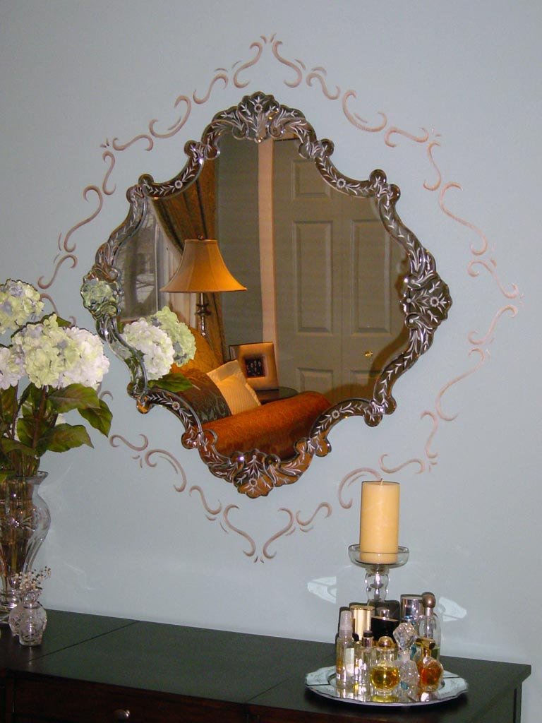 Decorative metallic silver border painted around Venetian glass mirror.