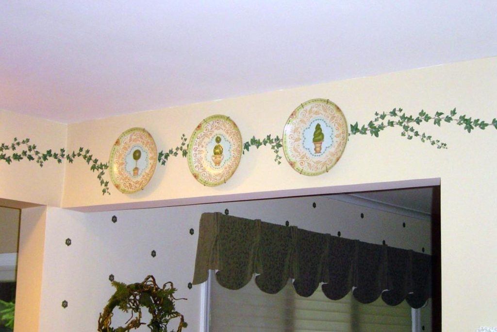 Decorative vine border painted around Kitchen walls.