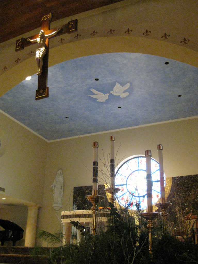 Paint finish with hand-painted doves on church ceiling. Gold-leaf fleur-de-lis on archway.