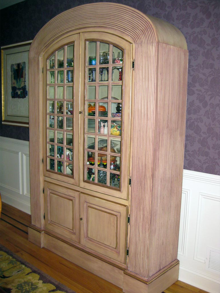 Deep eggplant glaze painted over contemporary cabinet.