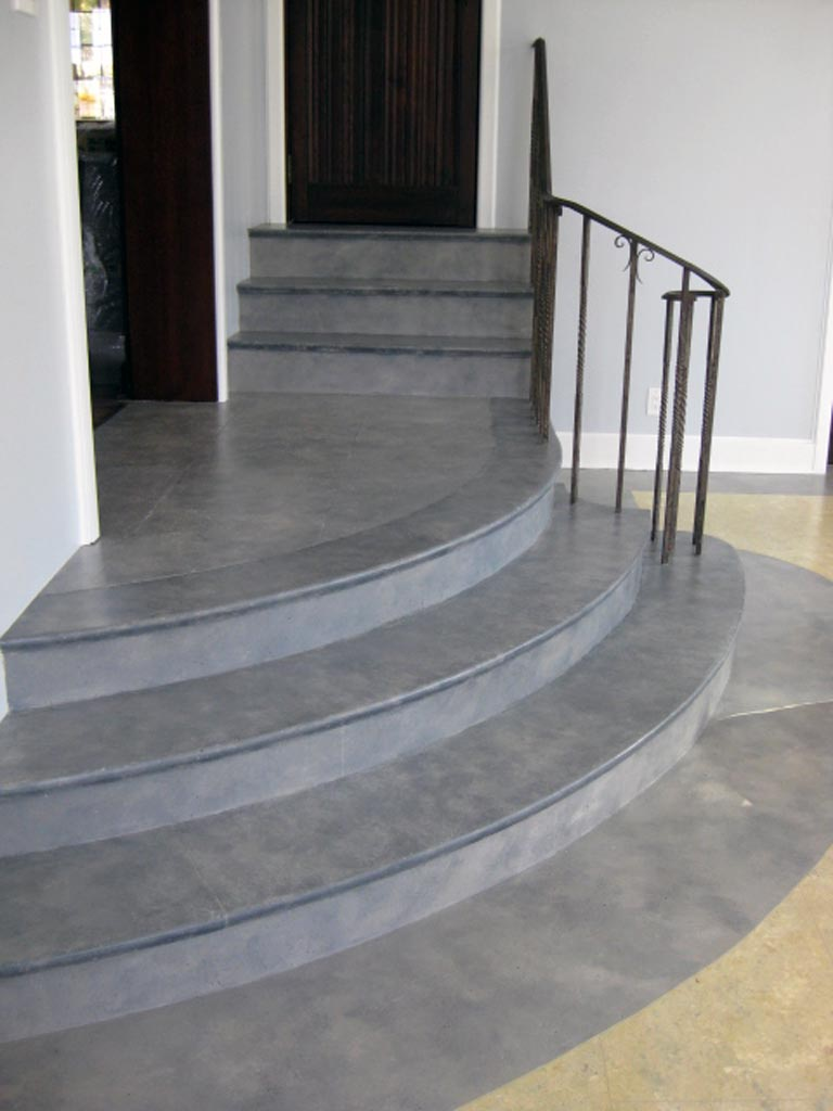 Slate finish painted on stairs and perimeter of floor in music room.
