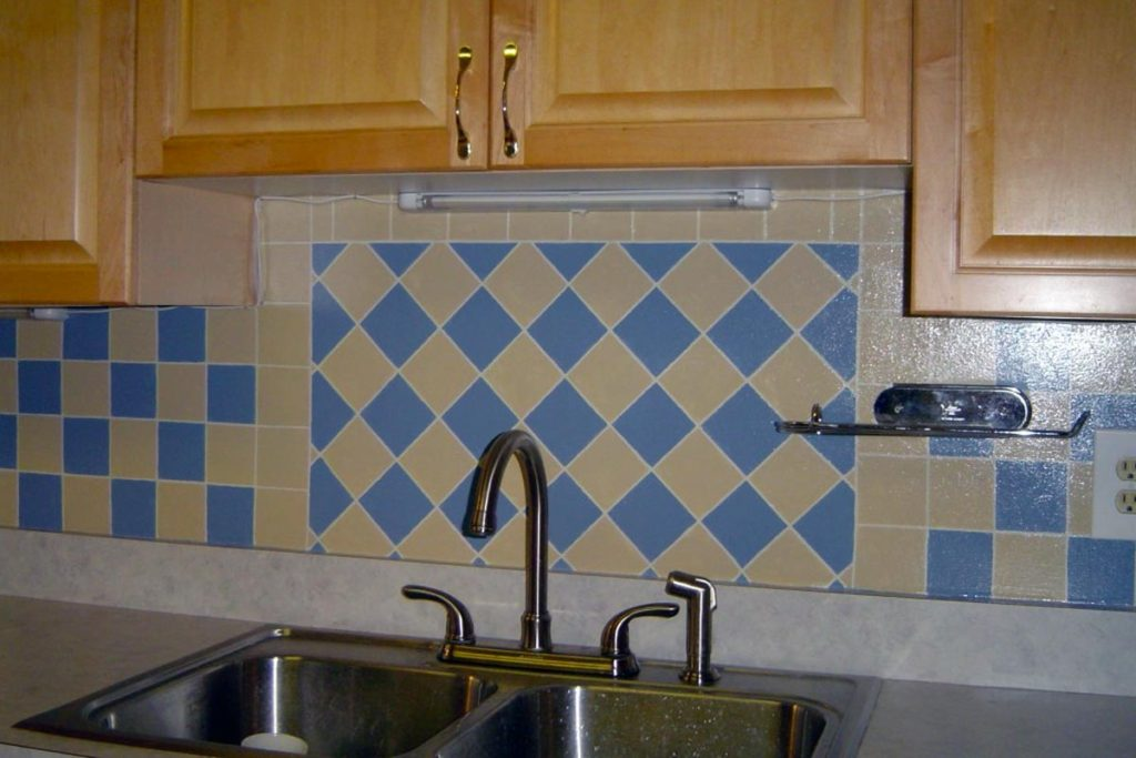 Faux tile painted on Kitchen backsplash. Faux tile painted on Kitchen backsplash.