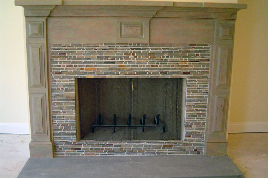 Newly constructed fireplace mantle painted in multi-layer distressed finish.