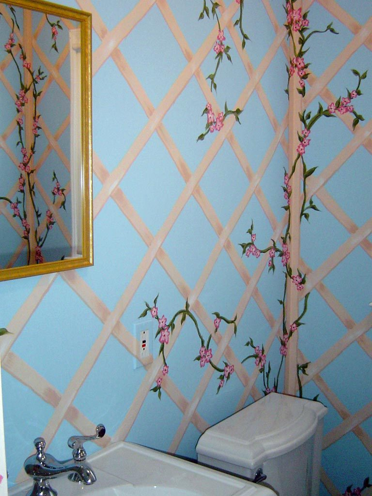 Floral and lattice design painted throughout powder room.
