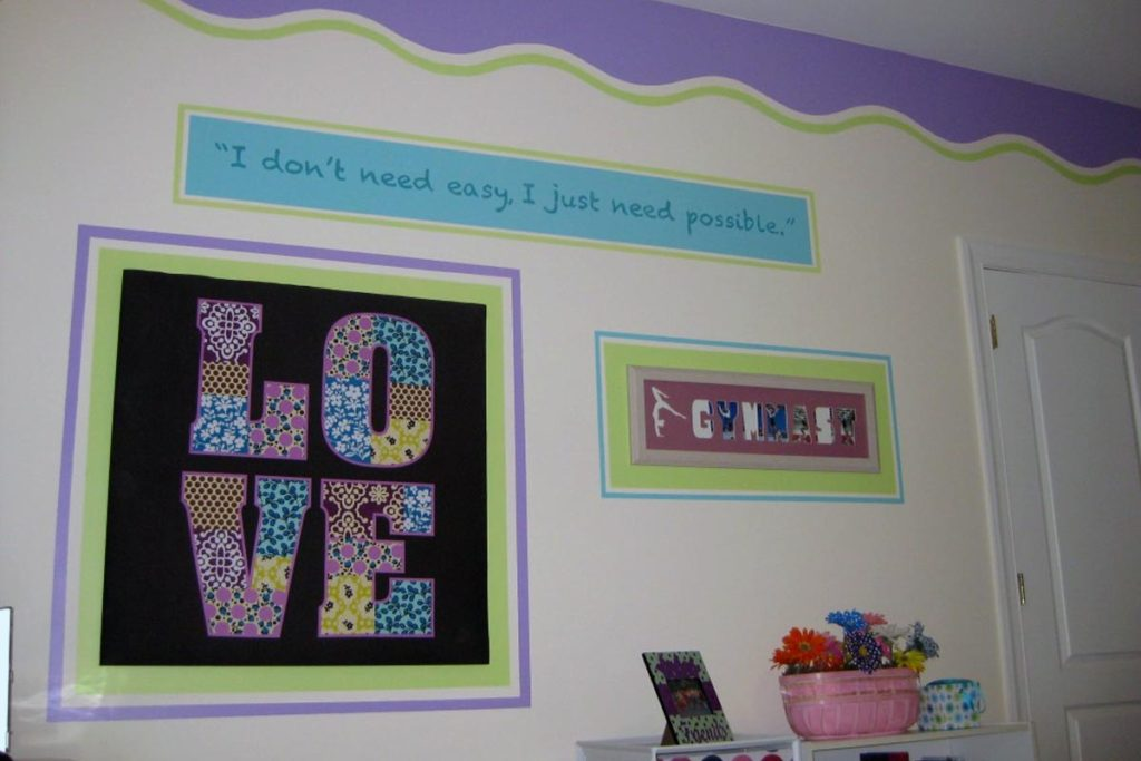 Bright graphic border and wall composition painted in girl's bedroom.