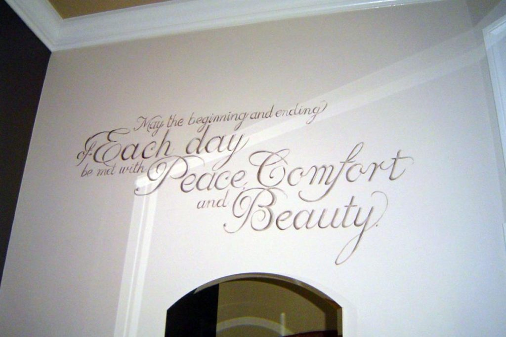Hand painted quotation in master bathroom.