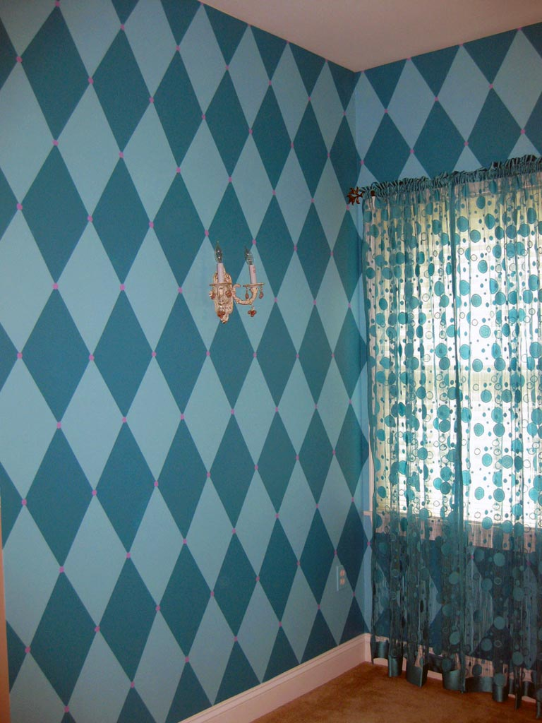 Bright harlequin diamond pattern painted in girl's bedroom alcove.