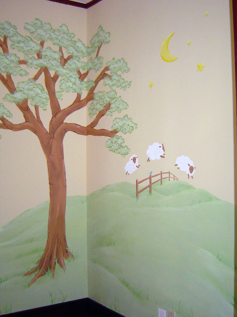 Nursery mural featuring sheep jumping fence.