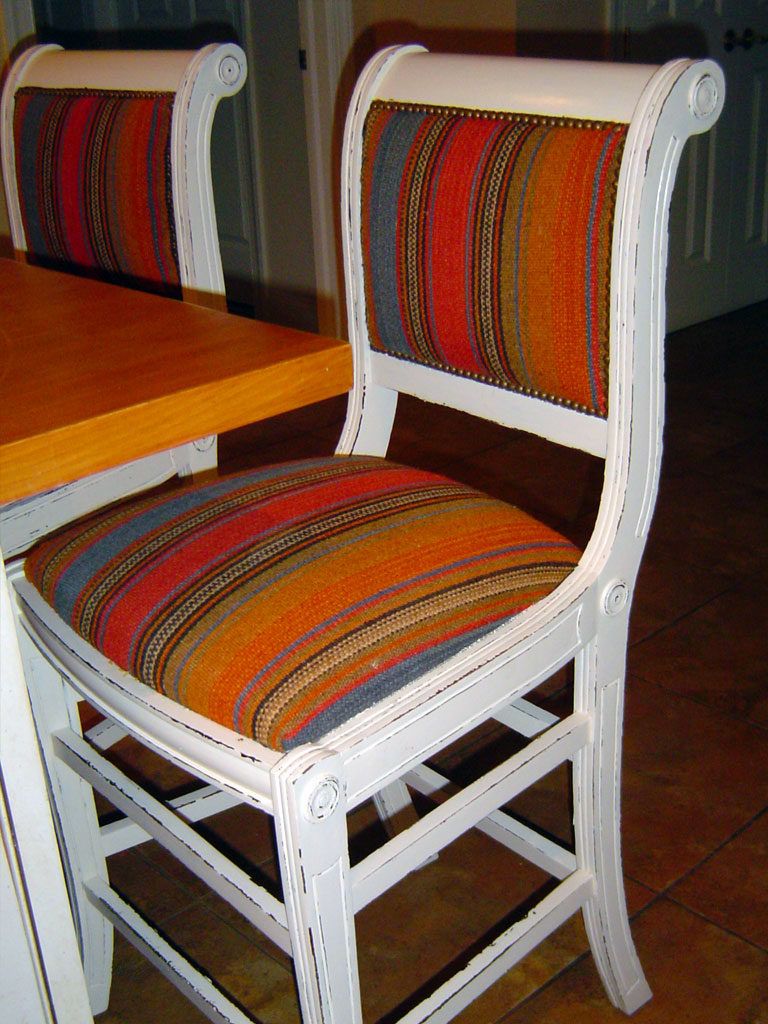 Set of Kitchen bar chairs painted and distressed to reveal base color at edges.