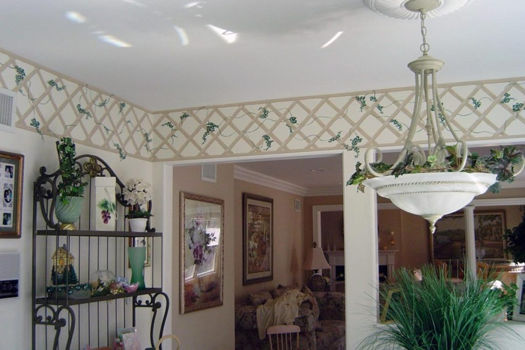 Lattice and vines painted as a border in kitchen.