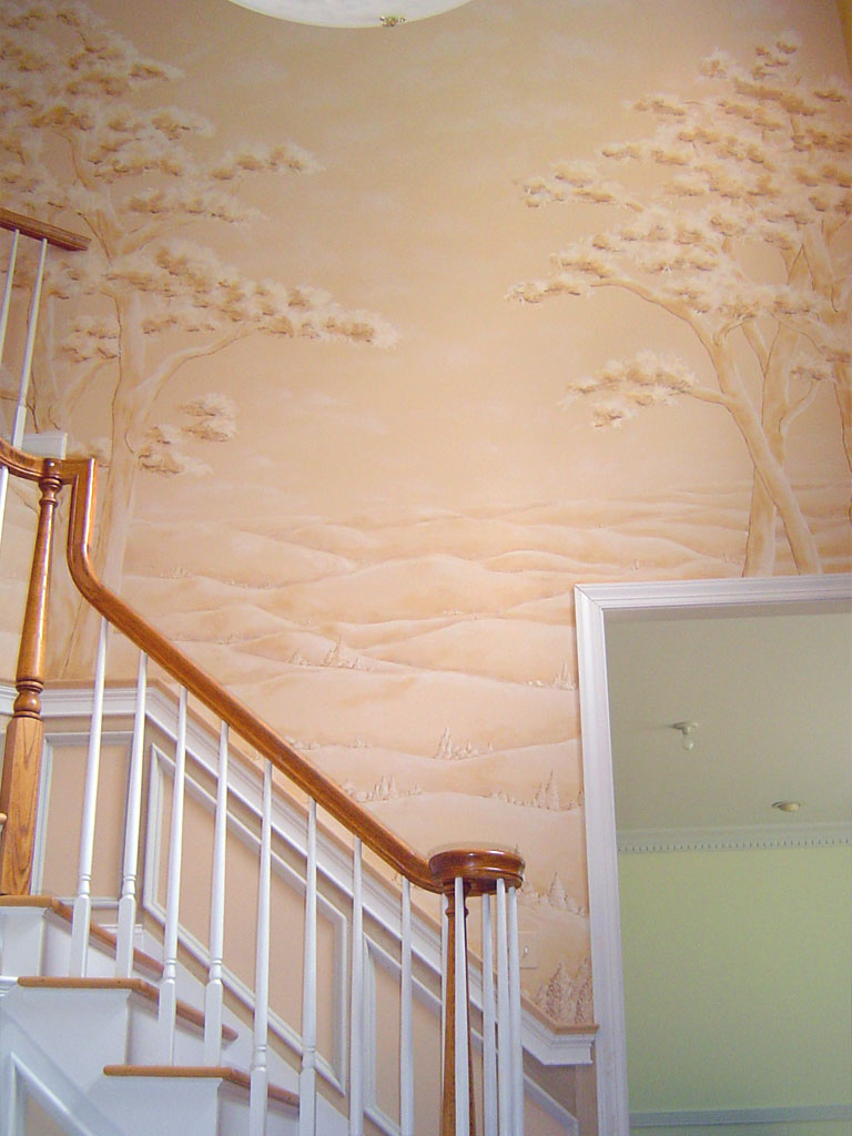 Monochromatic landscape mural painted on two-story foyer wall.