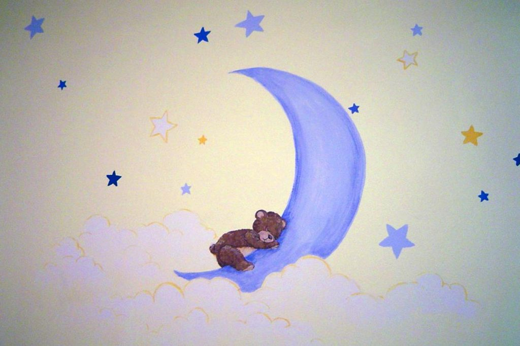 Nursery painted with bears, moon and stars.