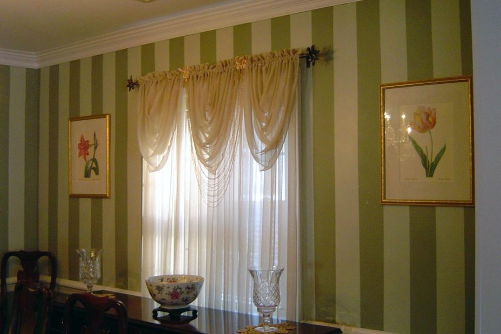 Olive green shadow stripe painted in dining room.