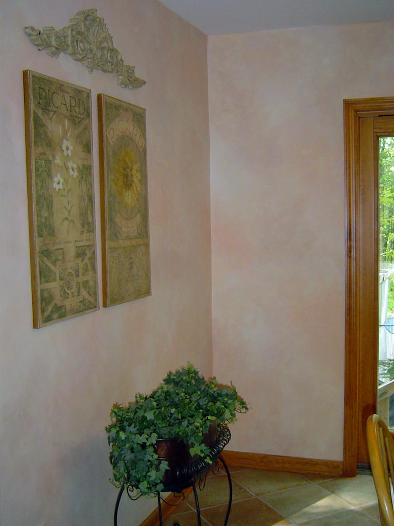 Peach, ivory, and khaki blended finish painted in kitchen.