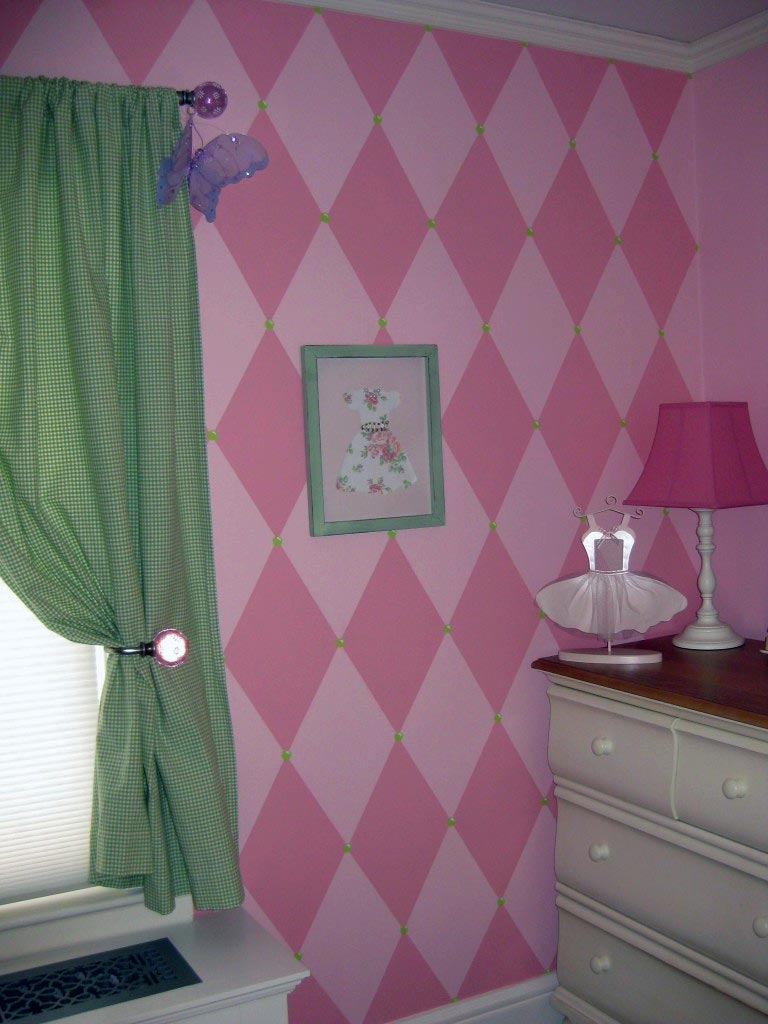 Pink harlequin design with green accents.