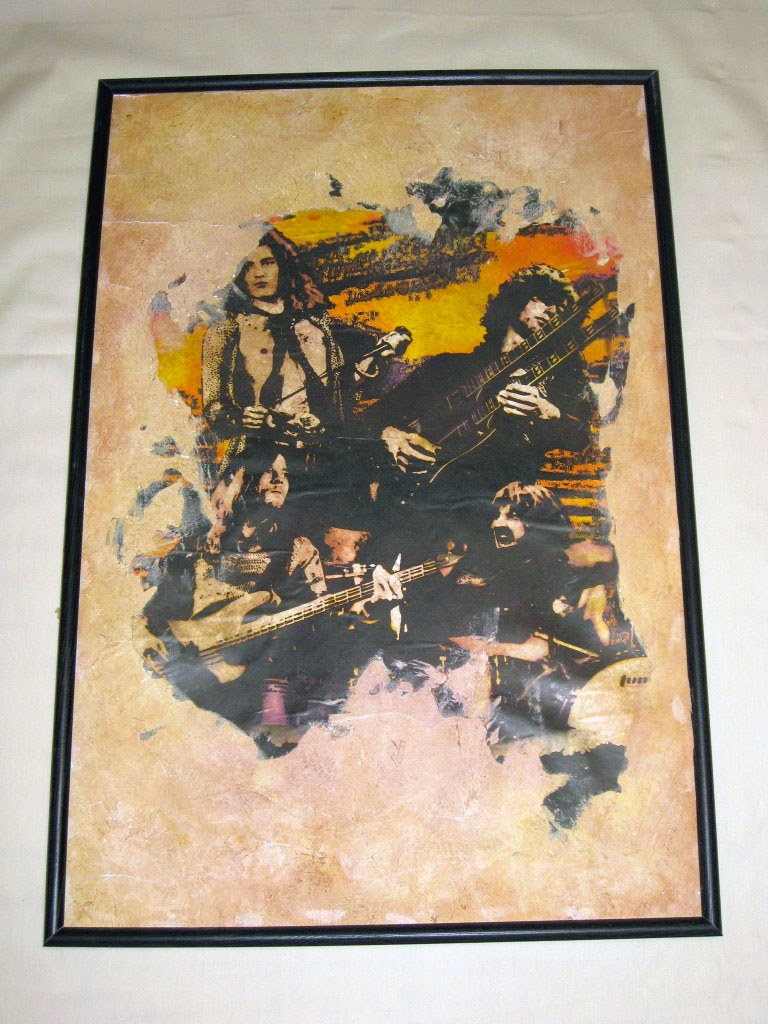 Poster image embedded in plaster, aged with colored glazes.