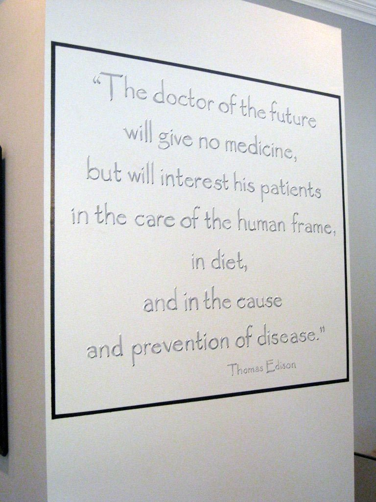 Quote painted on waiting room wall of chiropractor's office.