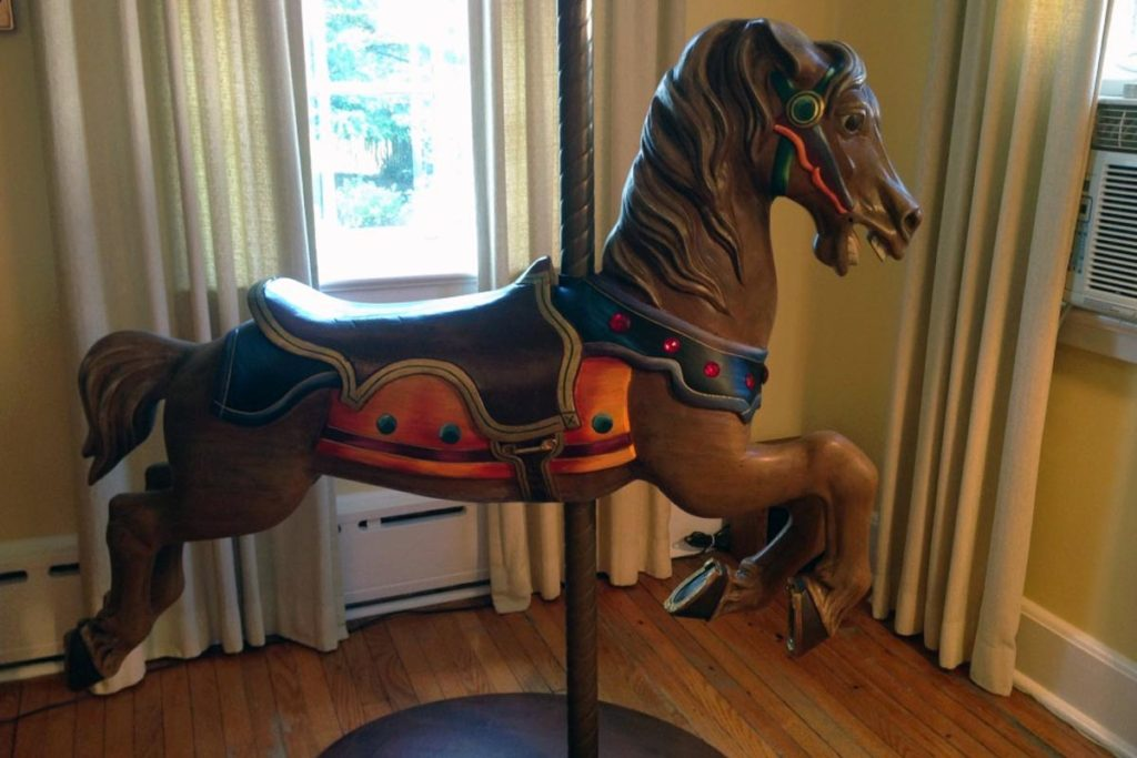 Restoration and repainting of antique carousel horse.