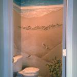 Seaside mural painted in windowless bathroom.
