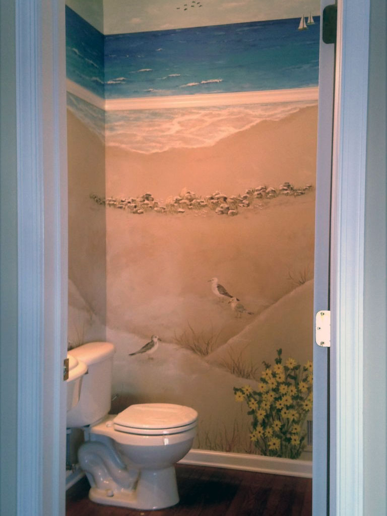 Seaside mural painted in windowless bathroom.