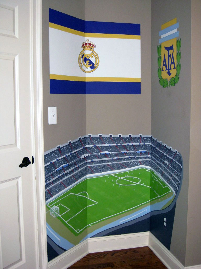Soccer-themed alcove painted with stadium and two team logos.