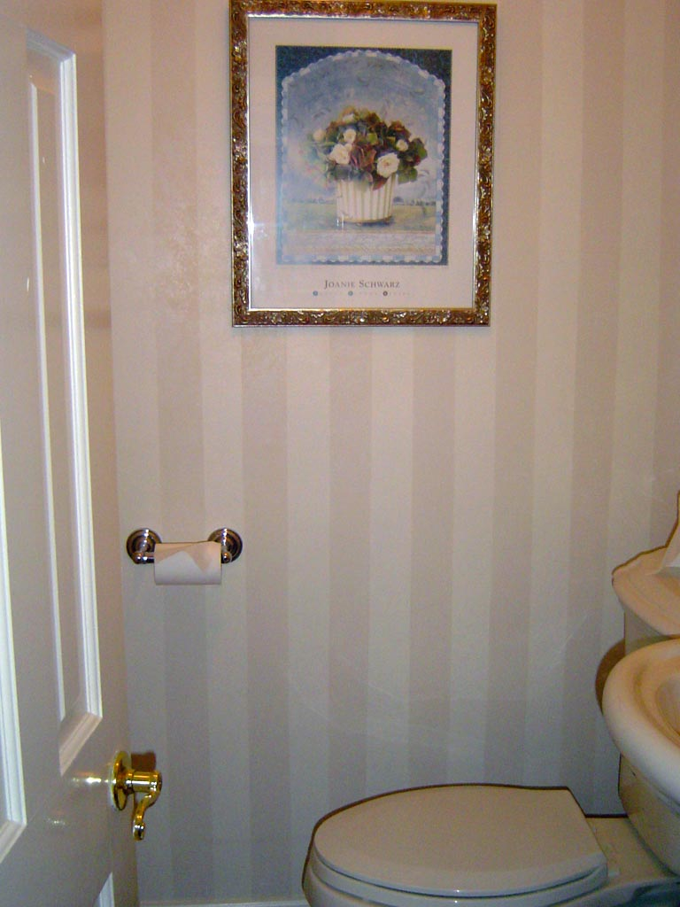 Shadow stripe painted in powder room with linen white glaze overall.