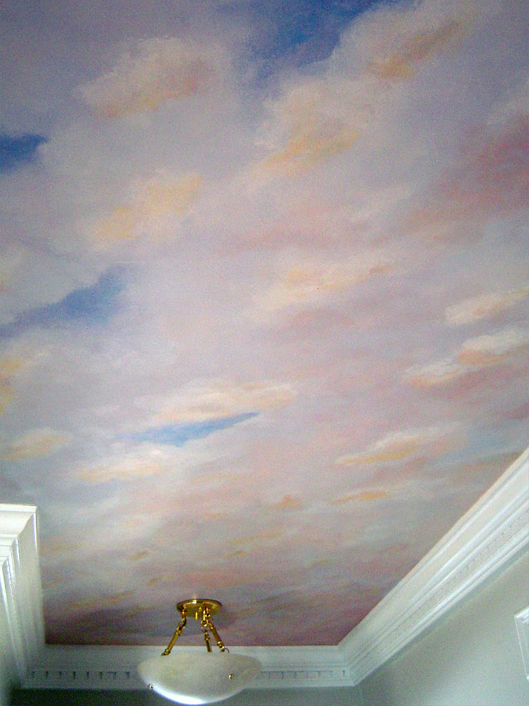 Ceiling painted with sunset sky.