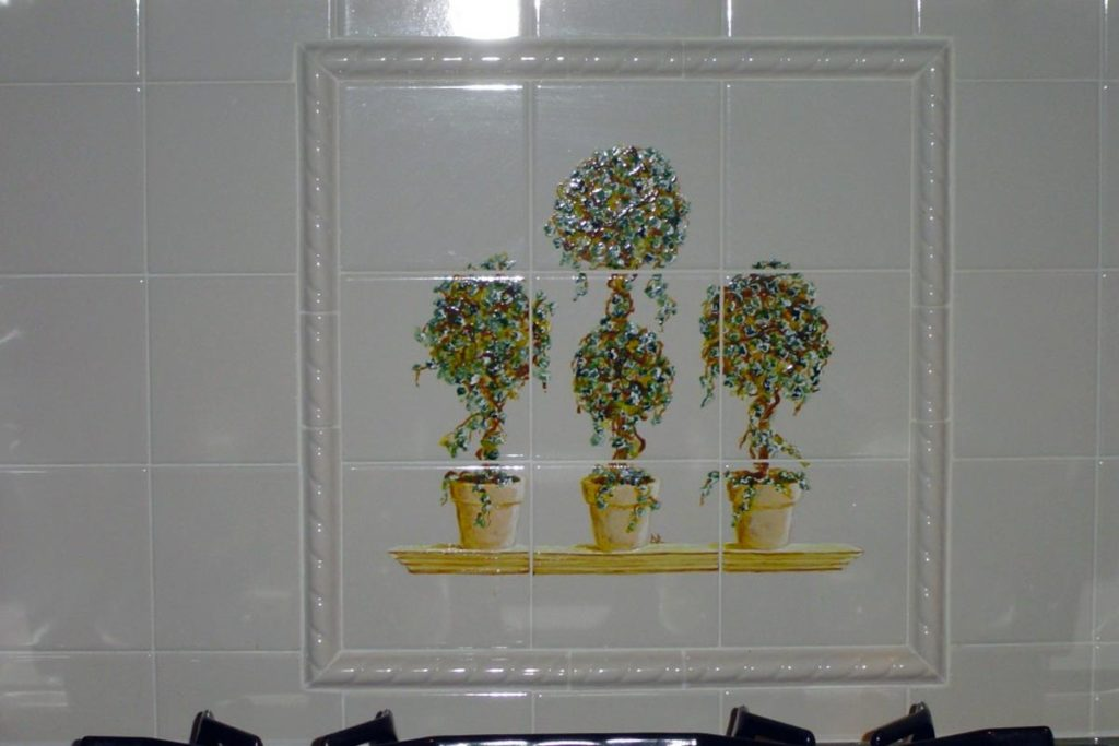 Topiaries painted on backsplash tile.