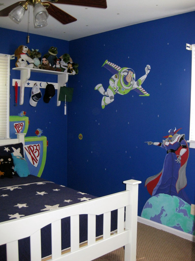 """Space Ranger Spin"" themed mural painted in boy's bedroom."