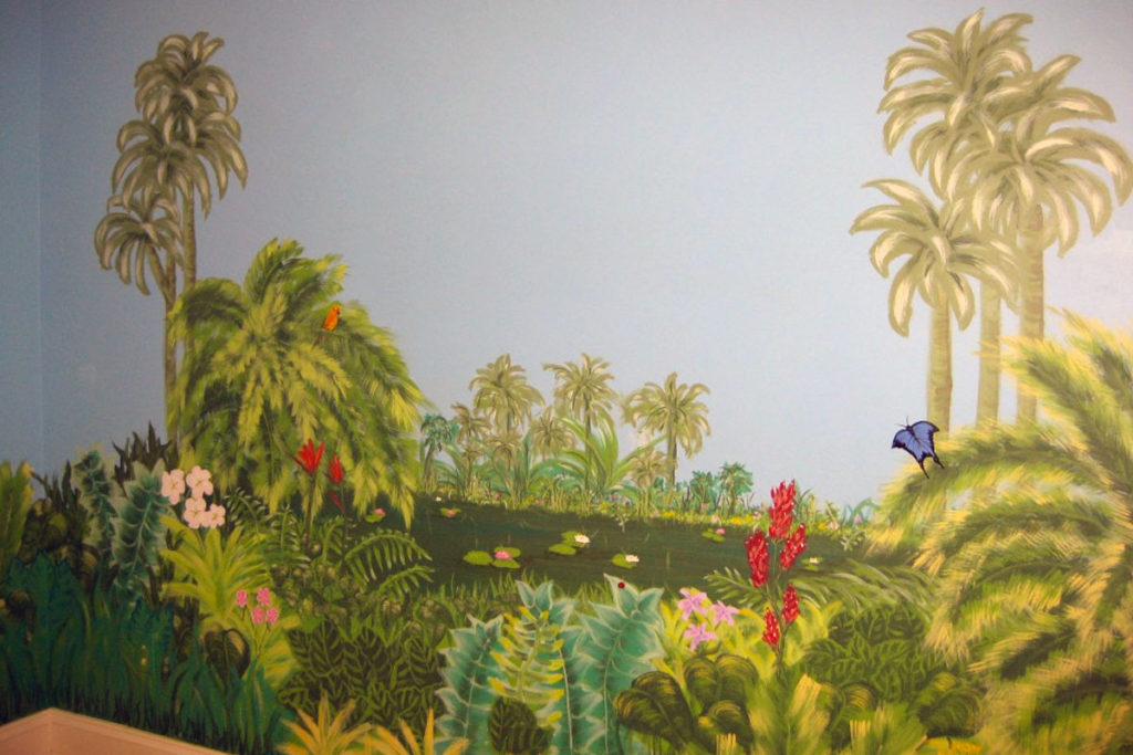 Tropical landscape mural painted throughout bedroom.