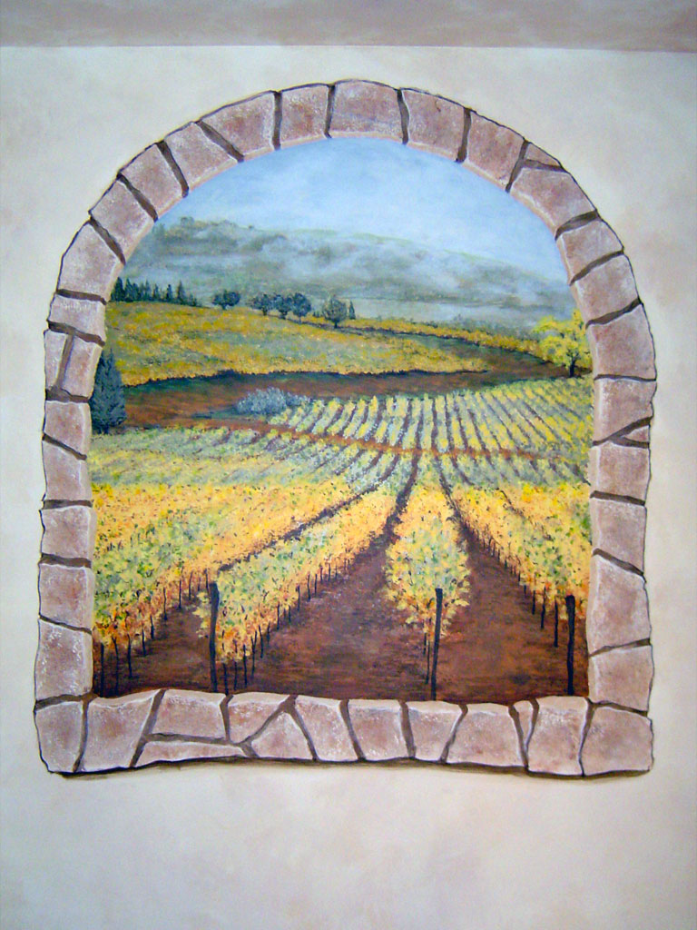 Faux window in textured plaster treatment painted with Tuscan vineyard mural.
