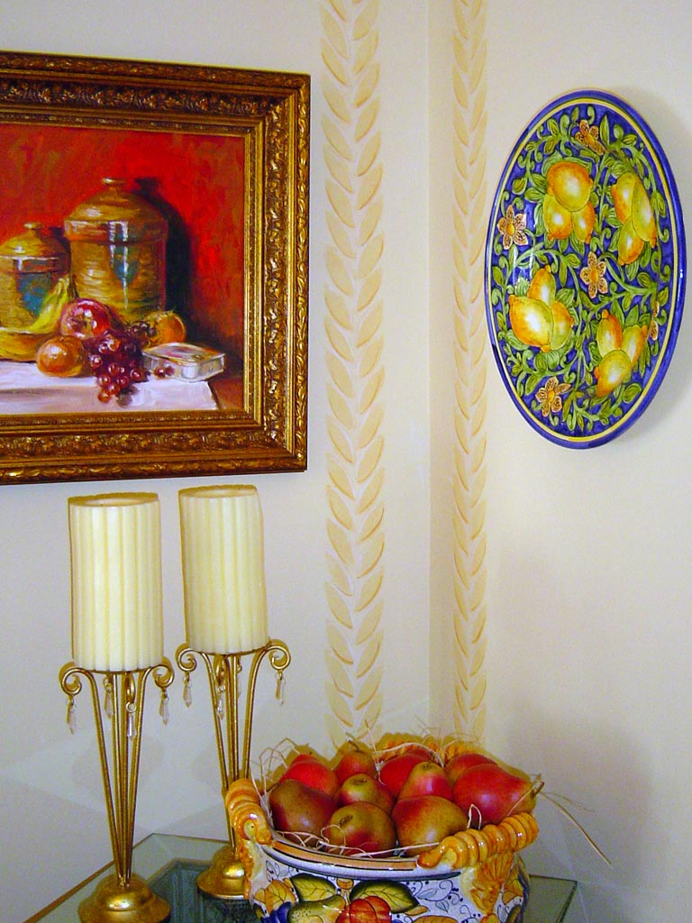 Custom wheat-sheaf design stenciled on dining room walls.