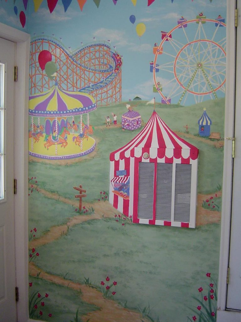Here is a fun mural I painted with an amusement park theme. The only problem? Look closely. Amusement park themed mural painted in playroom, incorporating wall-mounted heating unit in design. Amusement park themed mural painted in playroom.