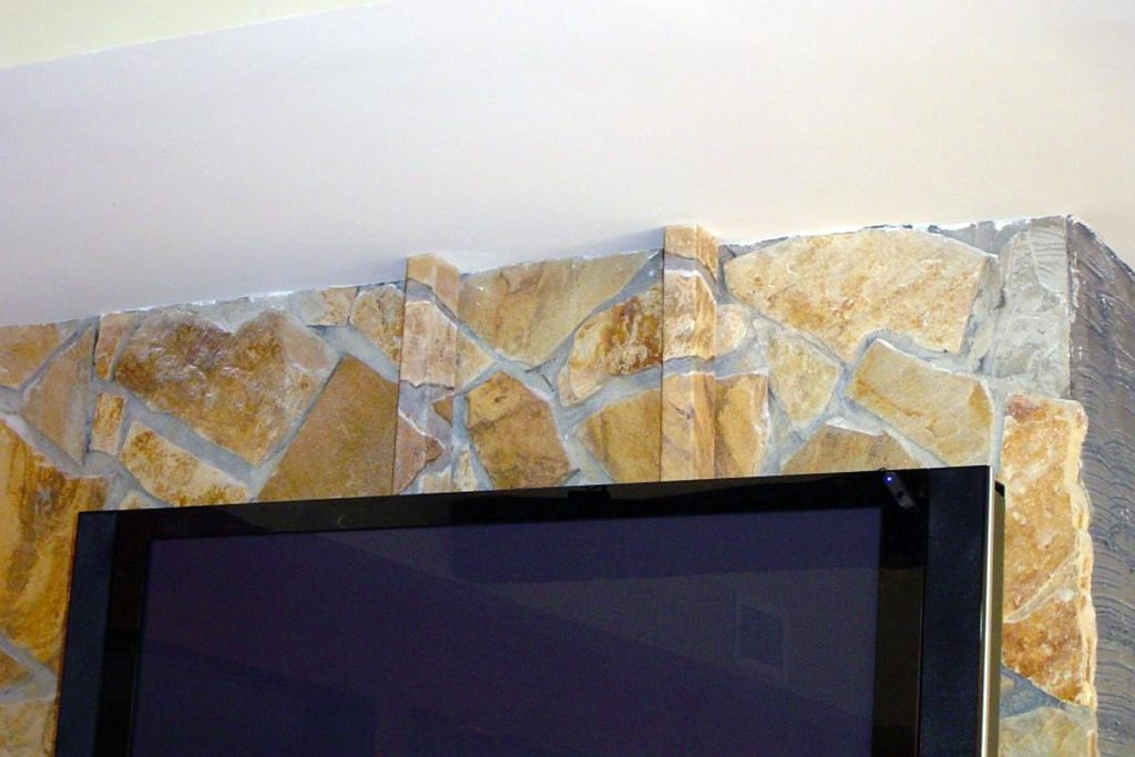 One of my favorites! The TV is mounted to a large stone wall above the fireplace, and the contractor built two wood channels to hide all the wiring. But what about hiding them? I painted them to line up and match the surrounding stones! Cable housing from TV mount painted to match and disappear into the stone wall.