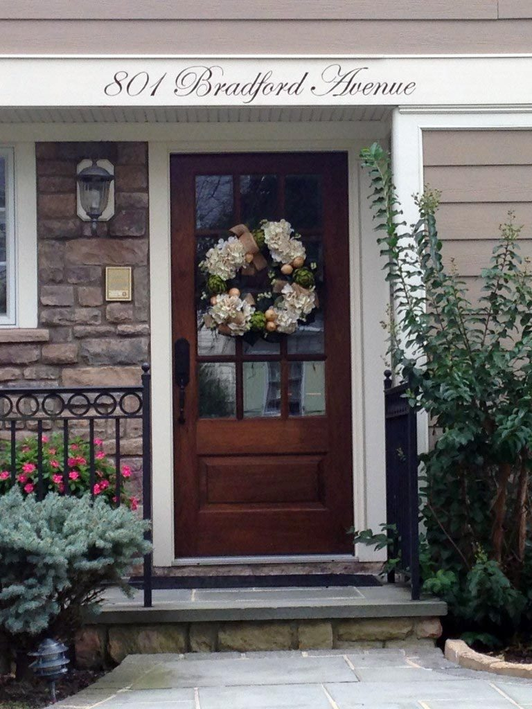 The curbside view shows that this address is an elegant complement to the style of the home.