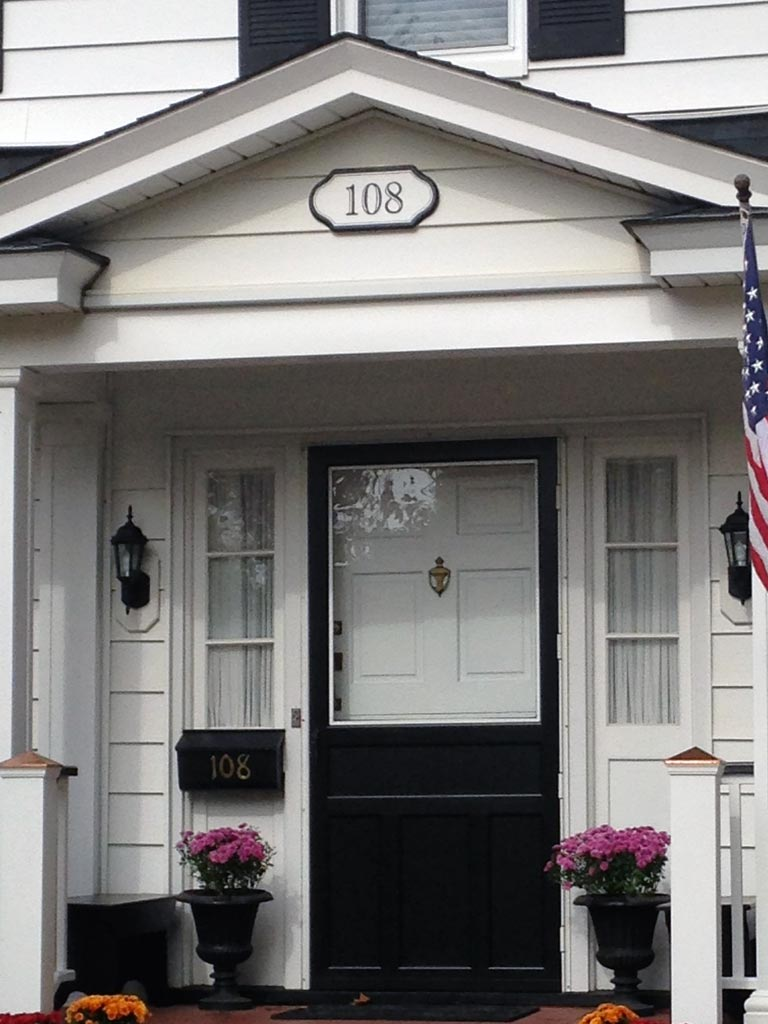 Home address plaque, curbside view, the simple black and white design looks just right for this colonial home.